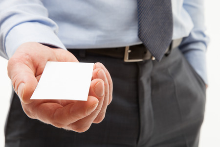 reaching out: Unrecognizable businessman reaching out visiting - closeup shot Stock Photo