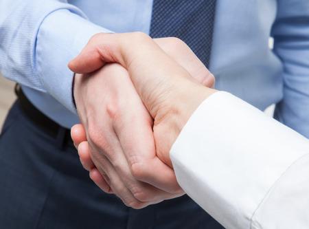 hands touch: Business handshake - closeup shot
