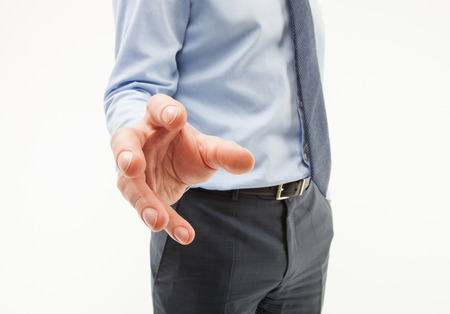 unpleasant: Unrecognizable businessman showing an unpleasant demanding gesture, white background