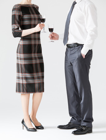 solemnize: Business people holding goblets of wine, white background Stock Photo