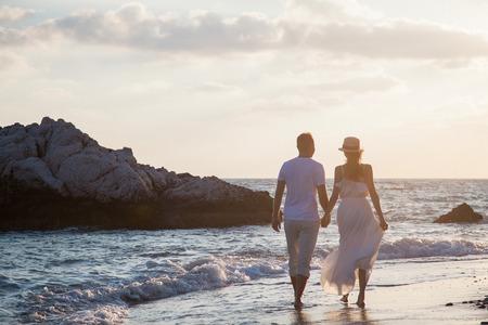 seacoast: Happy young couple walking along the seacoast Stock Photo