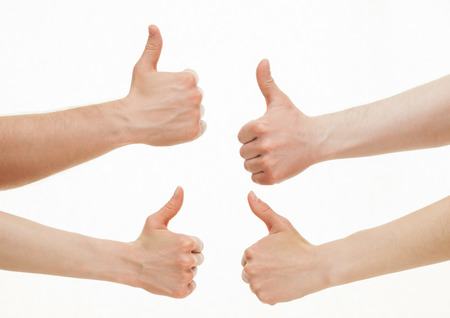 ok symbol: Four hands showing  thumb up signs on white background