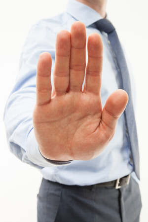 override: Unrecognizable businessman  demonstrating a gesture of a rejection, white background