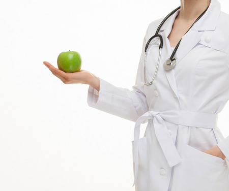 green apples: Doctor holding fresh green apples, white background Stock Photo