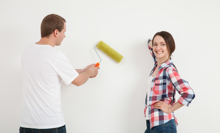 colourer: Happy young family repairing a new flat