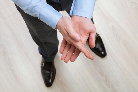 nonverbal: Unrecognizable businessman elucidating something nonverbal, closeup shot