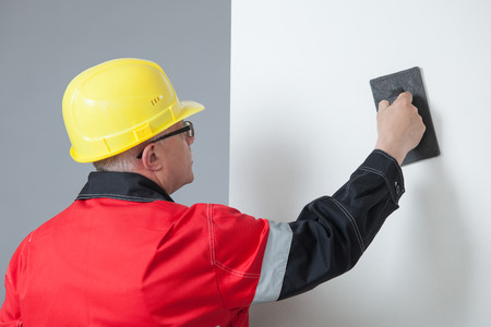 superintendent: Builder holding a trowel, gray background