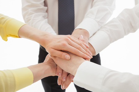 uniting: Business people uniting their hands - gesture of a uniion, white background