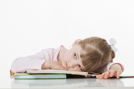 former years: Thoughtful little girl with a books, white background