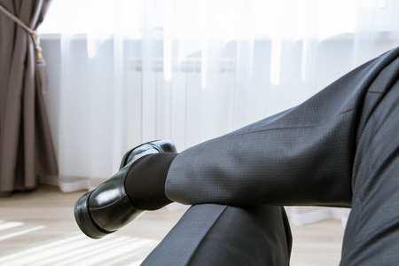 informal: Relaxed unrecognizable businessman in informal atmosphere - closeup shot