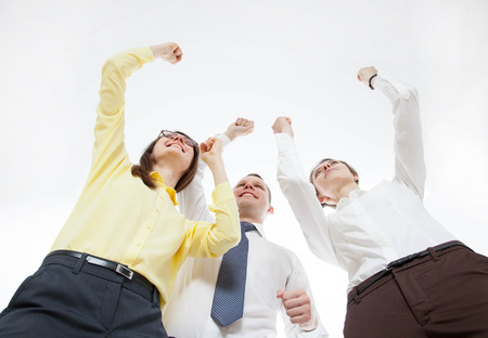 demonstrate: Business people demonstrate a gesture of triuph, bottom view