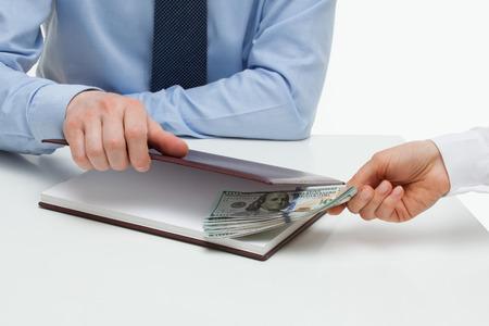 subornation: Businessman taking a bribe on workplace