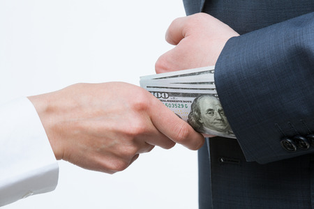 corruptible: Giving a bribe into a sleeve - closeup shot
