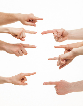 each: Fingers point to each other on white background Stock Photo