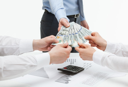 collaborators: Boss giving dollars to collaborators, white background