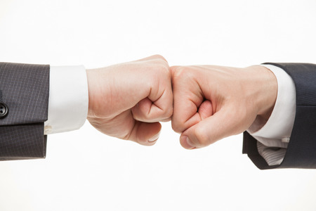 strife: Businessmans hands demonstrating a gesture of a strife, white background Stock Photo