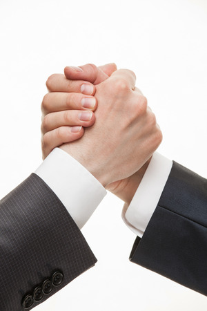 hand signs: Businessmans hands demonstrating a gesture of a strife or solidarity, white background