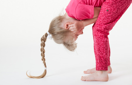 disinclination: Little girl bending and closing her ears, white background