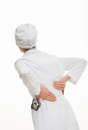 indisposition: Doctor touching small of the back, white background