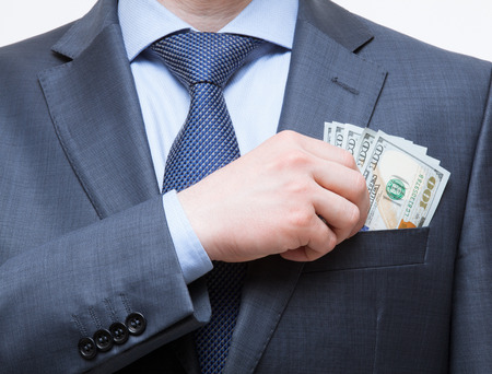 breast pocket: Businessman putting money in the breast pocket, closeup shot Stock Photo