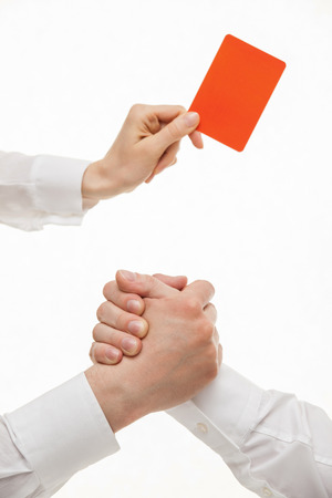 strife: Human hands demonstrating a gesture of a strife, one hand demonstrating a red card, white background Stock Photo