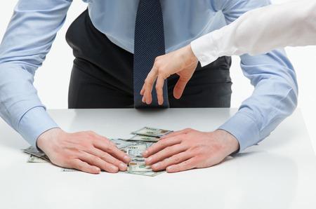 Businessman appropriating money, closeup shot