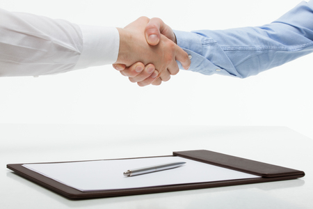 agreeing: Businessmen shaking hands each other, white background Stock Photo