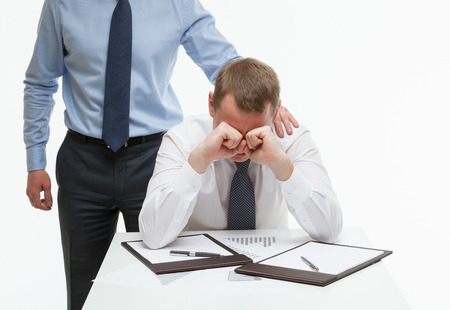 Businessman supporting his collegue in difficult situation, white background Фото со стока