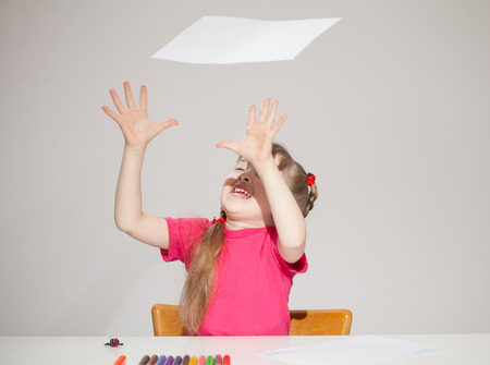 former years: Funny little catching a sheet of paper, grey background Stock Photo