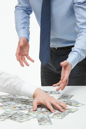 appropriate: Businessman appropriating money, closeup shot