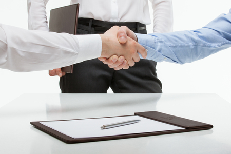 Businessmen shaking hands each other, white background Stock Photo