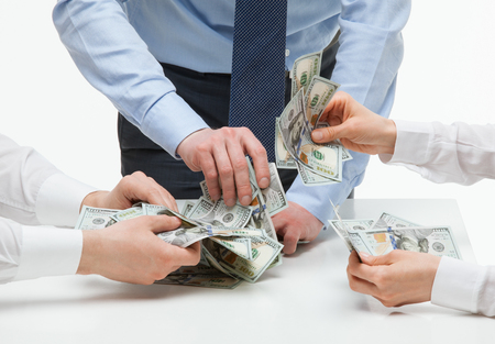 argumentation: Business people snatching money, closeup shot