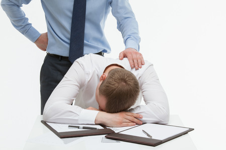 collegue: Businessman supporting his collegue in difficult situation, white background Stock Photo