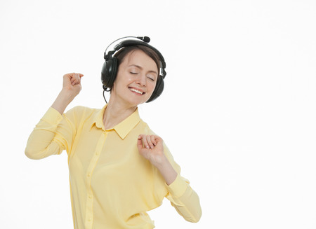 hark: Happy young woman enjoying music, white background Stock Photo
