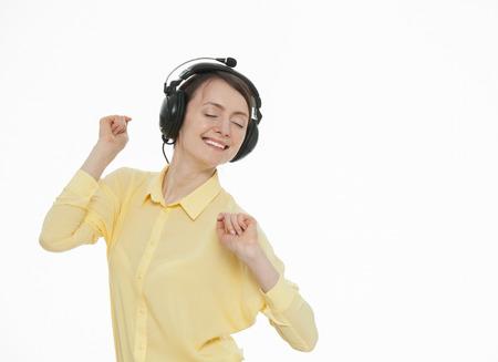 hark: Happy young woman enjoying music, white background Stock Photo