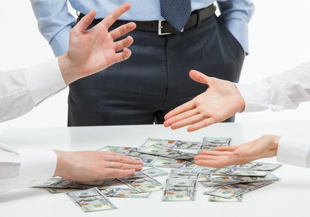 argumentation: Business people sharing money, white background