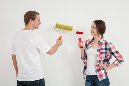colourer: Young couple discussing a renovation of a home, neutral background