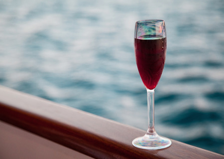goblet: Goblet with red wine on sea background Stock Photo