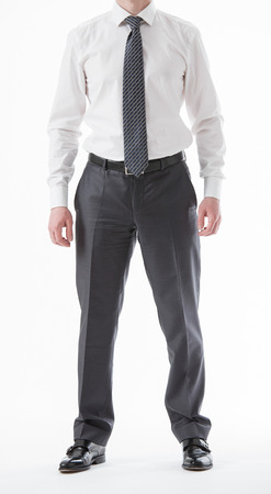 Unrecognizable businessman  standing in a pending pose, white background