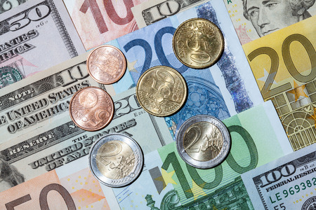augmentation: Capital augmentation: euro and dollar banknotes and euro coins Stock Photo