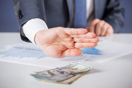 refusing: Businessman refusing money - closeup shot