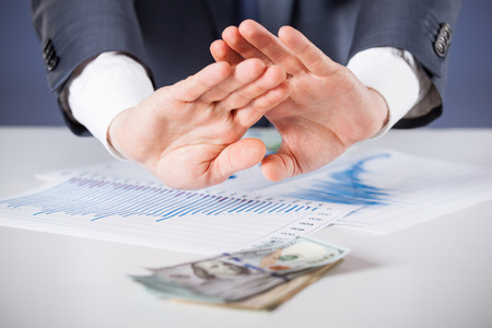 refusing: Businessman refusing money, dark background