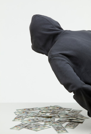 Unrecognizable robber stealing money, white background Stock Photo