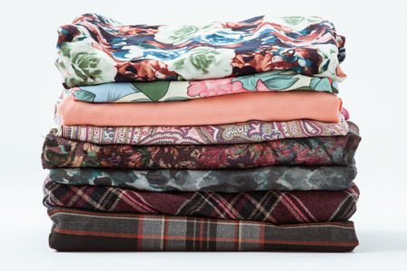 Pile of clothers on white background