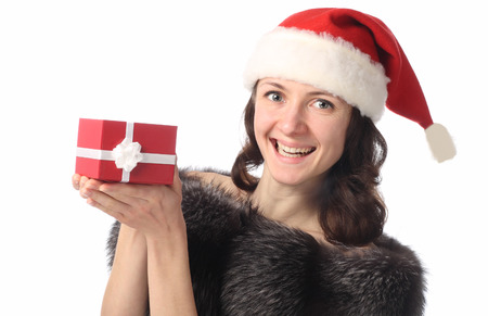 positiveness: Portrait of a beautiful young lady holding a present in red box and laughing isolated on white