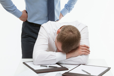 weary: Weary clerk sitting at the table and his dissatisfied boss standing behind , white background