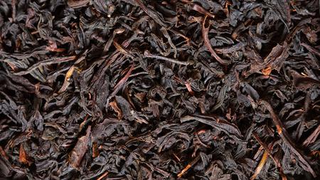 scattering: Scattering black tea. Macro.