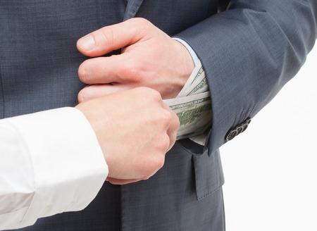 corruptible: Giving a bribe  - closeup shot Stock Photo