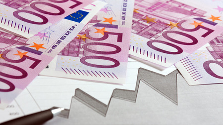 augmentation: Close-up of euro banknotes, graph and pen