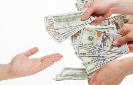 capital gains: Several hands put dollars in empty palm, white background
